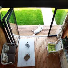 Maison bois G2: Jardin d'hiver de style  par yg-architecte