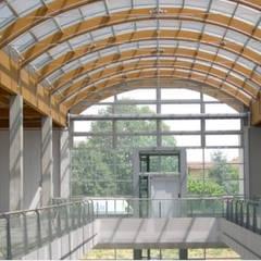 Grandi Magazzini Bossi: Centri commerciali in stile  di Cotefa.ingegneri&architetti