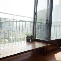 [홈라떼] 일산 32평 거주중인 집 홈스타일링 : homelatte의  베란다