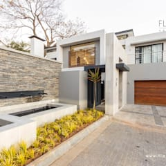 Salida del Sol Morningside:  Houses by Flaneur Architects