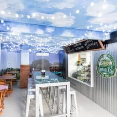 Confraria Kero: Espaços gastronômicos  por Kali Arquitetura