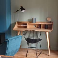 Rénovation et décoration d'un appartement à Lyon Bellecour: Bureau de style de style Industriel par VERTINEA
