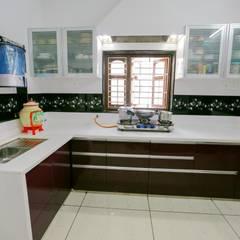 Shah Parivar Bungalow: modern Kitchen by ZEAL Arch Designs