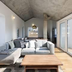 디귿집: 에이오에이 아키텍츠 건축사사무소 (aoa architects)의  거실