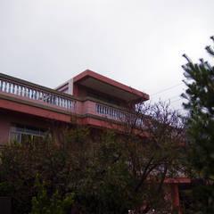二丁掛外牆:  房子 by 小滿工作室