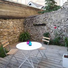 appartement G1: Jardin de style  par yg-architecte, Minimaliste Pierre