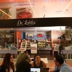 De Lolita - Unicentro: Espacios comerciales de estilo  por tresarquitectos