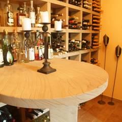 Weinregal mit Tisch aus Sandstein in Lauterbach:  Weinkeller von BOOR Bäder, Fliesen, Sanitär