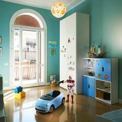 La stanza del bimbo.: Stanza dei bambini in stile  di Gruppo Castaldi | Roma