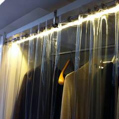 Loft: Spogliatoio in stile  di ibedi laboratorio di architettura
