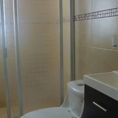 BJ.156 : Baños de estilo  por Urbe. Taller de Arquitectura y Construcción