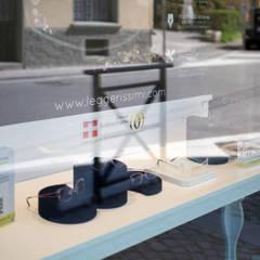 """La nuova Ottica Raineri, in stile """"classico"""": Negozi & Locali commerciali in stile  di FRANCO Arch. Emanuele - IDEeA Interior Design e Architettura"""