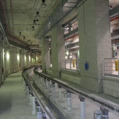 Bignami Underground Depot: Garage/Rimessa in stile  di Studio Associato di architettura MBiM