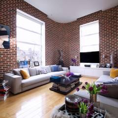London Loft:  Living room by JKG Interiors