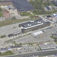 """""""Cityringen"""" - CMC: Garage/Rimessa in stile  di Studio Associato di architettura MBiM"""