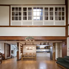 Living room by (주)에이도스건축사사무소