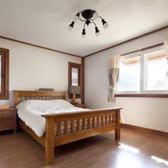 Bedroom by (주)에이도스건축사사무소
