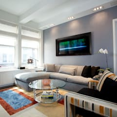 Bachelor Pad: classic Living room by JKG Interiors