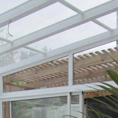 REMODELACION Y AMPLIACION DEPARTAMENTO EN VILLA LURO - CABA: Jardines de invierno de estilo  por Arquitecta MORIELLO
