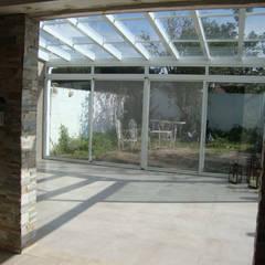 REMODELACION Y AMPLIACION DEPARTAMENTO EN VILLA LURO - CABA: Jardines de invierno de estilo  por ARQUITECTA MORIELLO,Moderno