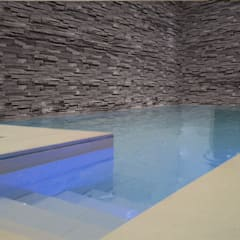 Luxury pool with a moving floor that closes the pool with a solid floor:  Pool by London Swimming Pool Company, Modern