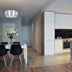 Mieszkanie 80m2 - Wiślane Tarasy: styl , w kategorii Jadalnia zaprojektowany przez INNers - architektura wnętrza