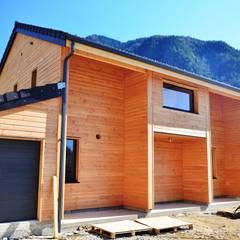 Maison ossature  bois ORLU 09.: Maisons de style  par Falco Construction Bois