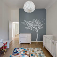 Nursery/kid's room by Mon Concept Habitation