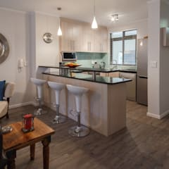 Holiday Let apartments:  Kitchen by Nailed it Projects