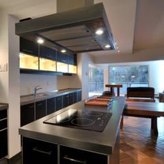 مطبخ ذو قطع مدمجة تنفيذ Nicolas Loi + Arquitectos Asociados