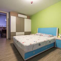 小孩房:  嬰兒房/兒童房 by 果仁室內裝修設計有限公司