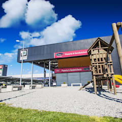 STRIP CENTER LOS NOTROS: Centros Comerciales de estilo  por surarquitectura