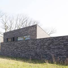 Energiepositieve woning:  Passiefhuis door Joris Verhoeven Architectuur, Minimalistisch