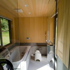 【平屋】スローライフを満喫-Rise-: 株式会社スタジオ・チッタ Studio Cittaが手掛けた浴室です。