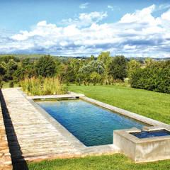 SISTEMAS DE RIEGO, CÉSPED: Jardines de estilo  de jardinista