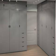 L'espace dressing - à droite pour madame, à gauche pour monsieur (entre les 2 la porte de la salle de bain): Dressing de style de style Moderne par MJ Intérieurs