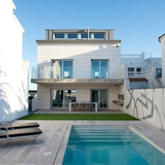 Proyecto integral de vivienda en el mar: Casas de estilo minimalista de HD Arquitectura d'interiors