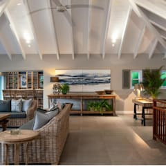 Beach Front House:  Living room by JSD Interiors
