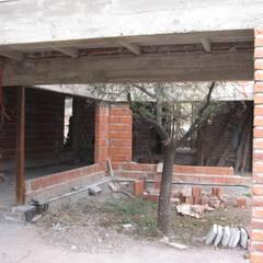 Casa MH: Jardines de invierno de estilo  por Development Architectural group