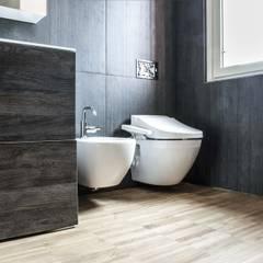 Baños de estilo  por estudoquarto s.r.l., Minimalista Madera Acabado en madera