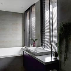 Baños de estilo  por 釩星空間設計