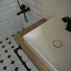 黑色基地:  浴室 by 釩星空間設計