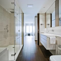 REFORMA DE VIVIENDA EN VALENCIA: Baños de estilo moderno de Aguilar Arquitectos