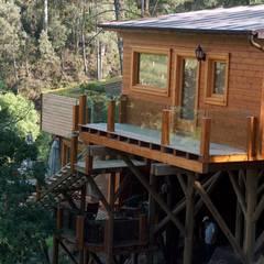 RUSTICASA | Casa suspensa | Monção: Casas de madeira  por Rusticasa