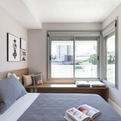 Dormitório aconchegante: Quartos  por Studio Cinque