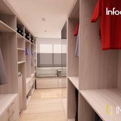 INTERIORISMO: Habitación con vestidor y baño integrados, Ausias March (Valencia): Vestidores de estilo  de IMPATTO