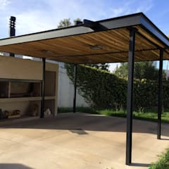 QUINCHO/GARAGE MPG: Casas de estilo minimalista por Development Architectural group
