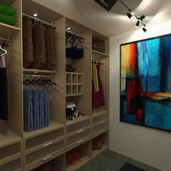 Vivienda Unifamiliar: Closets de estilo  por N.A. ARQUITECTURA, Moderno
