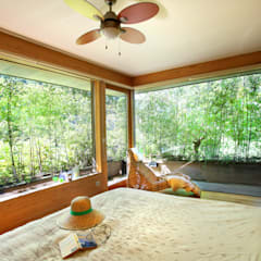 Dormitorios de estilo asiático por Rusticasa