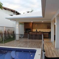 Varanda gourmet: Casas  por Arquiteta Bianca Monteiro